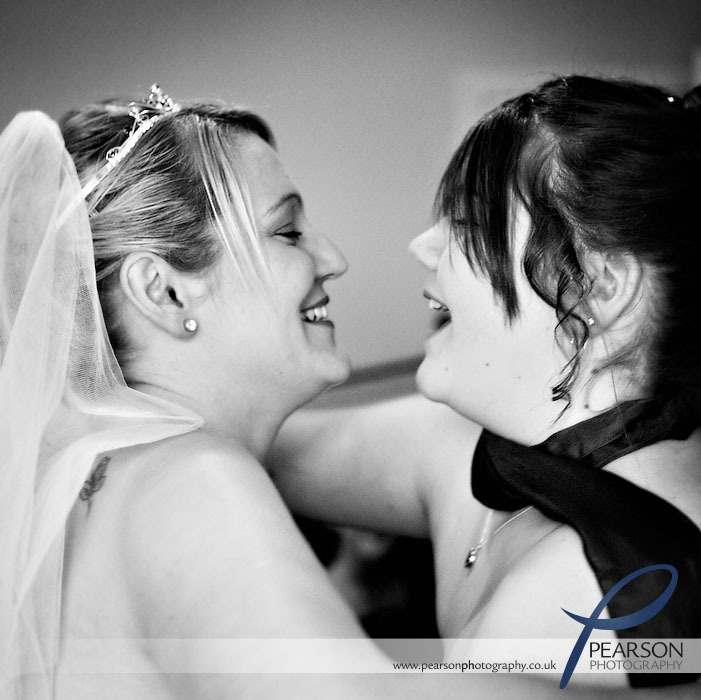 Bride and Daughter Hug